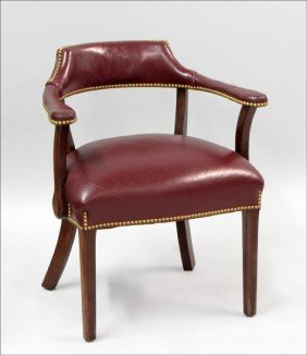 LEATHER-UPHOLSTERED MAHOGANY LIBRARY CHAIR.