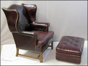 KITTINGER LEATHER CHAIR AND OTTOMAN.