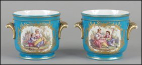 PAIR OF SEVRES PAINTED AND GILT PORCELAIN CACH