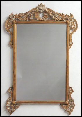 CARVED PINE MIRROR.