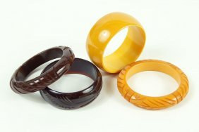 Two Brown Carved Bakelite Bangle Bracelets.
