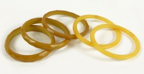 A Group Of Three Faceted Honey Bakelite Bangle