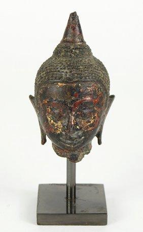 A 16th Century Thai Bronze Head Of Buddha.