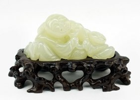 A Chinese Carved Jade Figural Group.