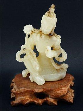 A Carved White Jade Buddha Figure.
