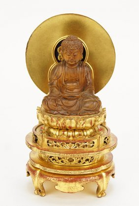 A Chinese Qing Dyansty Carved And Gilt Buddha.