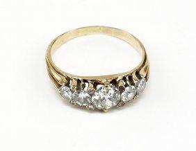 A Diamond And 14 Karat Yellow Gold Ring.