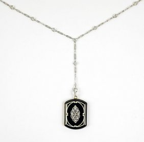 An Art Deco Locket And Chain.