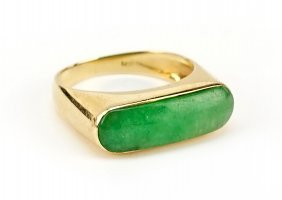 A Jade And 14 Karat Yellow Gold Ring.