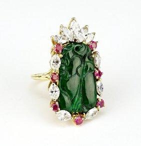 A Jade And 18 Karat Yellow Gold Cocktail Ring.