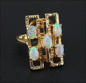 An Opal And 14 Karat Yellow Gold Ring.