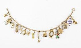 A 10 Karat Gold Charm Bracelet.