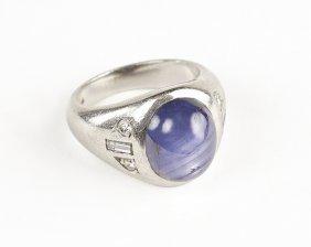 A Platinum, Diamond, And Star Sapphire Ring.