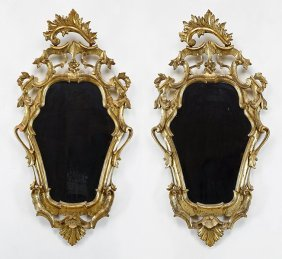 A Pair Of Italian Baroque Style Giltwood Mirrors.