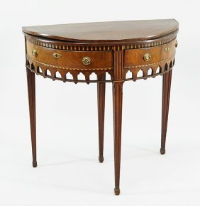 An English Inlaid Mahogany Demilune Table.