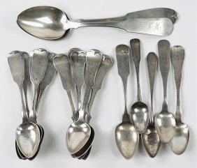 A Set Of Twelve Coin Silver Teaspoons.