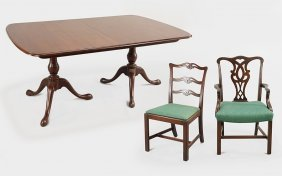 A Chippendale Style Mahogany Dining Set.