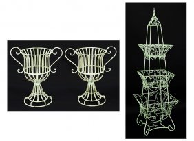 A Pair Of Urn Form Basket Planters.
