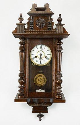 A German Carved Walnut Regulator Clock.