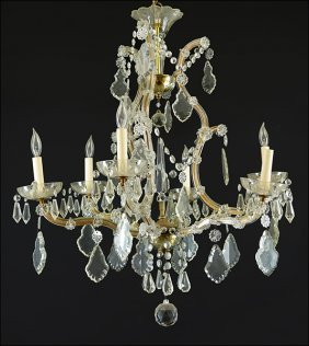 A Cut Crystal Six-light Chandelier.
