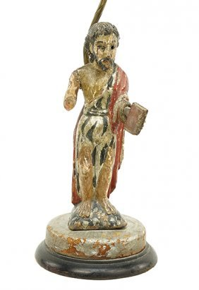 A Santos Figure Of St. John The Baptist.