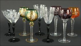 A Collection Of Black And Clear Glass Wine Glasses.