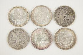 Six Morgan Silver Dollars.