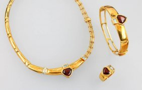 Set Of 18 Kt Gold Jewelry With Garnets And Aquamarines