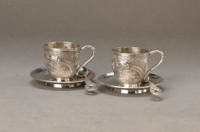 2 Cups With Saucers And Spoons