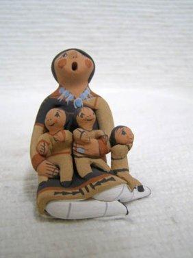 Native American Jemez Storyteller With Three Little