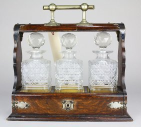 Edwardian Walnut Tantalus, Having Three Cut Glass