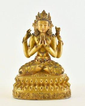 15TH C. MING GILT BRONZE FOUR ARMS BUDDHA, YONGLE MARK