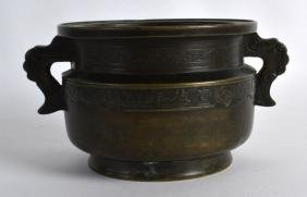 A GOOD 18TH CENTURY CHINESE TWIN HANDLED BRONZE CENSER