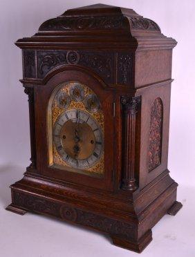A Huge Victorian Carved Oak Bracket Clock By Sir John