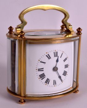 An Early 20th Century French Oval Brass Carriage Clock