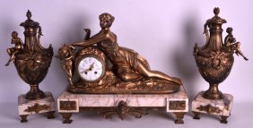 A 19th Century French Gilt Metal Clock Garniture