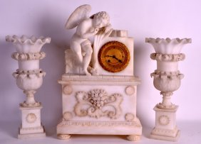 A 19th Century French White Marble Clock Garniture