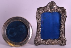A Victorian Silver Repousse Photograph Frame Together