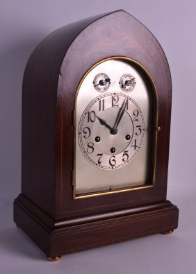 An Edwardian Mahogany Arched Mantle Clock With Silvered