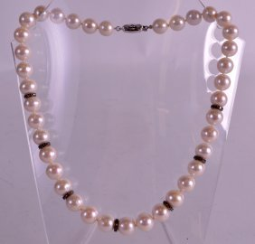 An 18ct White Gold Diamond And Pearl Necklace.