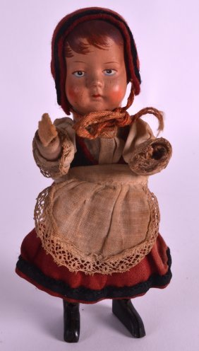 An Early 20th Century German Wind Up Tin Plate Doll