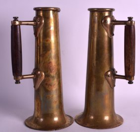 A Pair Of Art Nouveau Polished Brass Flagons With