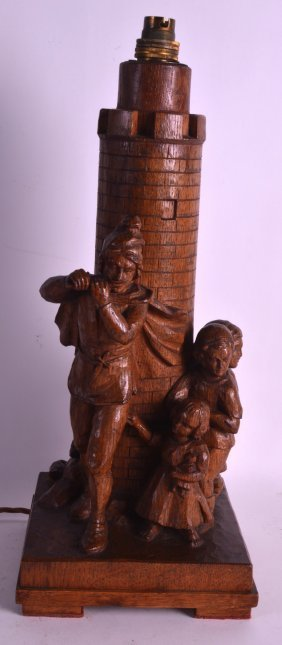 An Arts And Crafts Carved Wooden Table Lamp Unusually