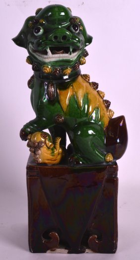 A Late 19th Century Chinese Green Glazed Dog Of Foe