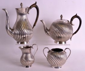 A Victorian Four Piece Silver Teaset By William And