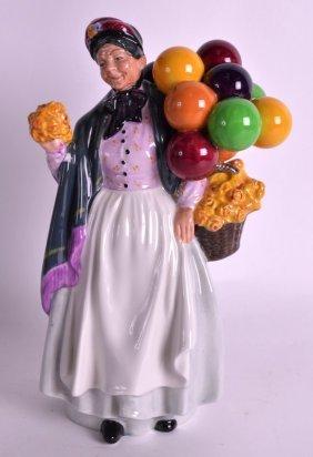 A Royal Doulton Figure 'biddy Pennyfarthing'. 8.75ins