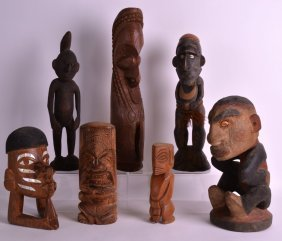 A Collection Of Polynesian Carved Wood Figures In