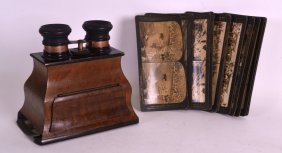 A Late Victorian/edwardian Stereo Viewer Together With
