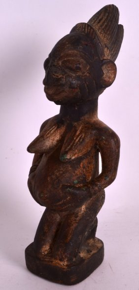 An Early 20th Century Yoruba Carved Wood African Figure