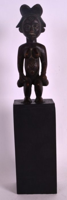 An Early 20th Century African Carved Wood Figure